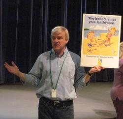 Chris Van Dusen spoke to children at the Reach Performing Arts Center