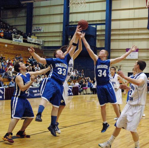 Dylan Brown and Connor Morey go for a rebound
