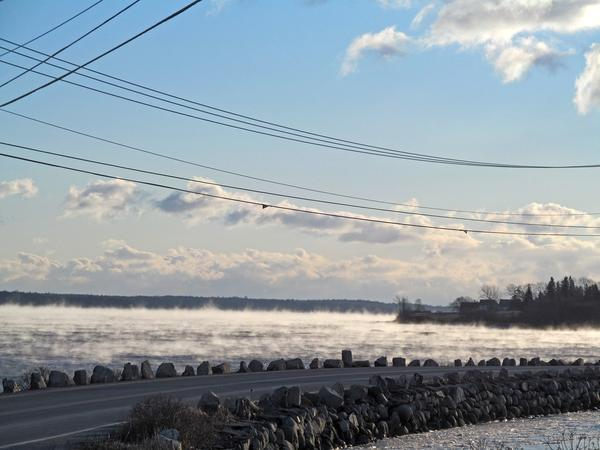 Frigid air produces sea smoke along the Deer Isle causeway