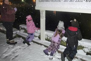 Parade of Lights watched by children at Winterfest