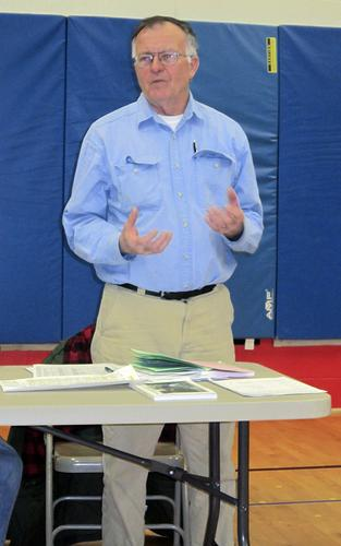 Brooksville Selectman John Gray details funding increases at the 2014 Brooksville, Maine town meetin
