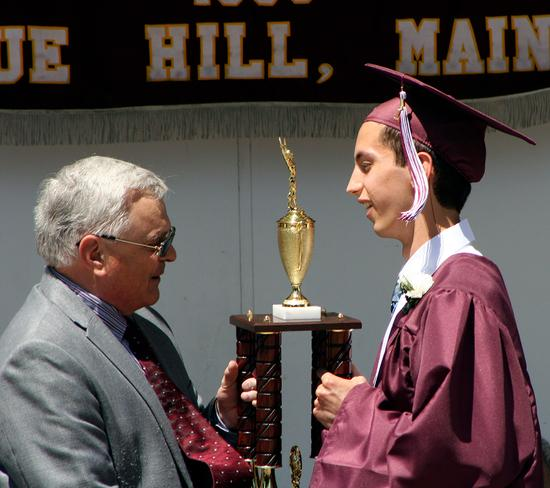 Jim Murphy awards student athlete Philip Shaheen at GSA commencement