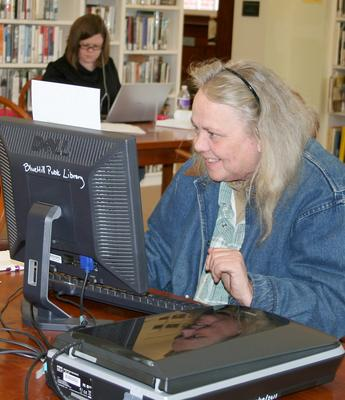 A researcher at Blue Hill Public Library in Maine