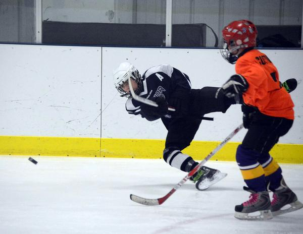 Blue Hill, Maine youth helps Junior Black Bears hockey team to a championship win