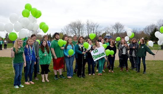 Deer Isle-Stonington High School students released balloons in support of Brandon Higgins