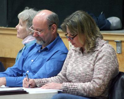 Selectmen listen to the reading of the warrant at Brooklin Town Meeting
