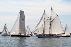 Isobel, center left, races against a classic Fife yacht