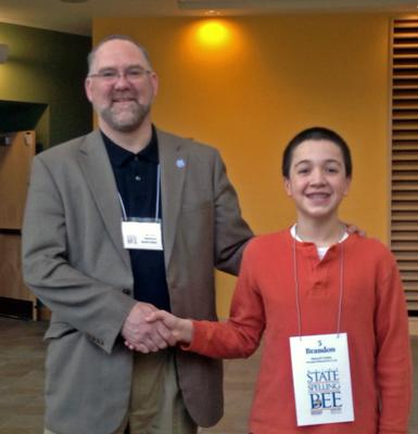 Brandon Aponte with Maine State Spelling Bee judge Michael Ashmore