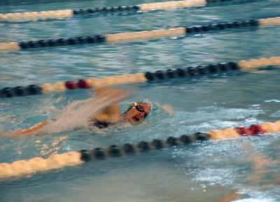Beth Ann Avery swims the last lap of her event