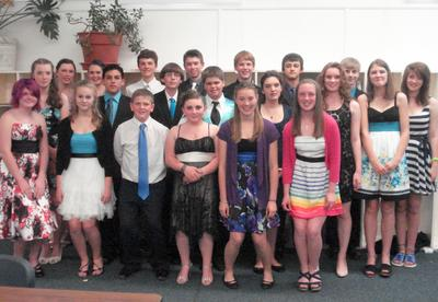 The twenty-one members of Blue Hill Consolidated School eighth grade class