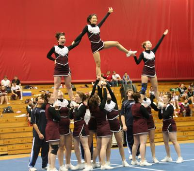 Cheering team meets goal; falls short at regionals