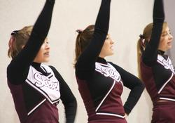 Cheerleaders encourage the boys varsity basketball