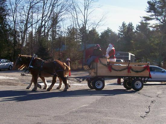 Santa arrives at ECS by horse-drawn carriage