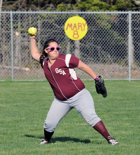 Abby Nowalnd winds up a pitch.