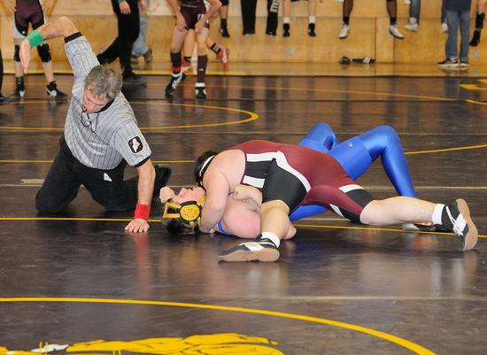 Senior Tim Allen pins his opponent