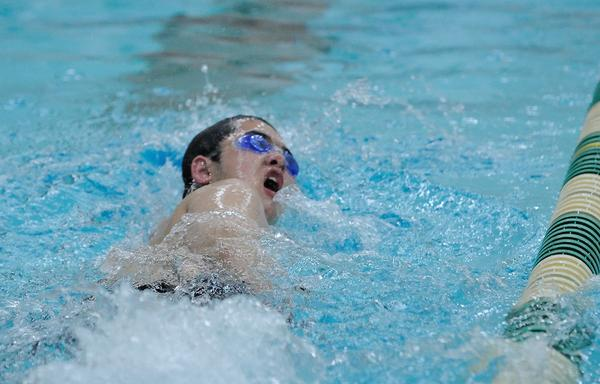Junior Brian Bian swims the 50-yard freestyle