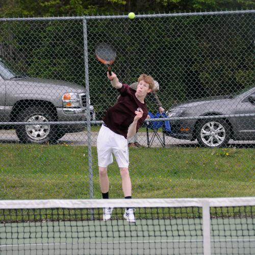Nick Dillon serves during a doubles match
