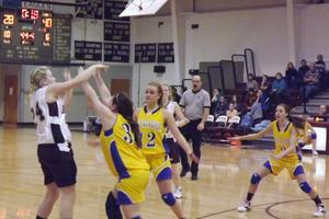 Abby Brady passes across the court