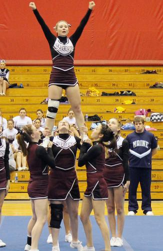 The Eagles cheering squad performing a stunt