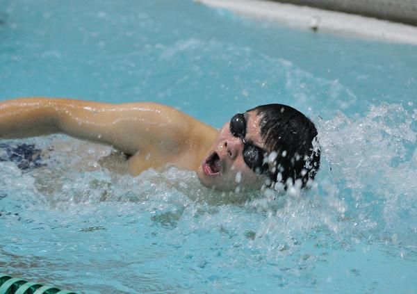 Sophomore William Cheng swims the 100 yard freestyle