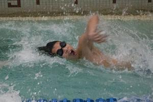 C.J. Chen swims a leg of the 200-meter freestyle relay