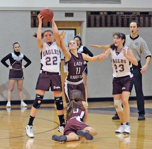 Junior Jennifer McKenney  takes the rebound