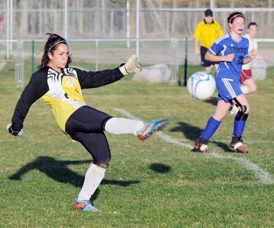 Goalkeeper Megan Nowland saves and kicks