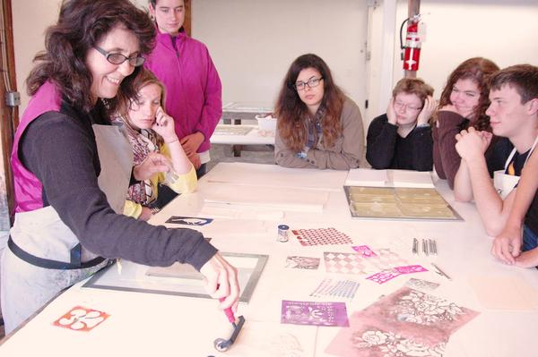 Haystack's Susan Webster gives a printmaking demonstration to students