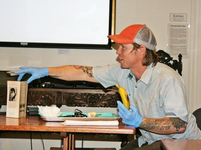 Corey Paradise gives a talk on the history and meaning behind tattoos,