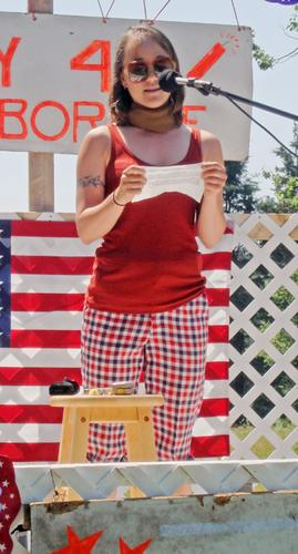 Sarah Klain gives a speech at the Harborside 4th of July parade