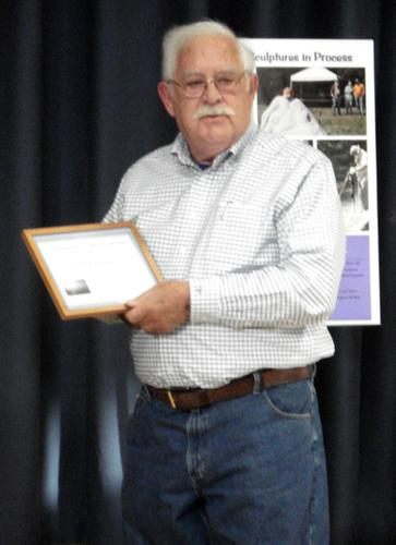 Ted Fletcher with his community service award