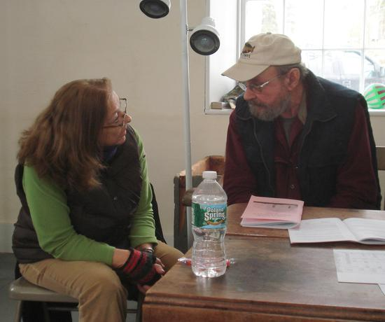 Cindy Reilly talks town office business with Colby Pert