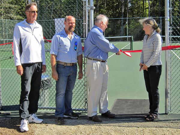 Albie Smith cuts the ribbon at the Brooklin Public Courts