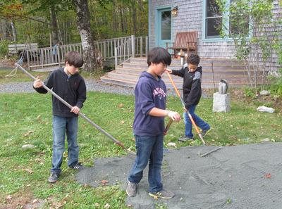 Fifth graders work on paths at Bay School's Applefest in Blue Hill