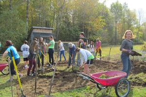 An outdoor classroom under construction at Bay School's Applefest in Blue Hill