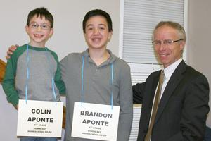 Second-place winner Colin Aponte, champion Brandon Aponte and judge Jim Newett