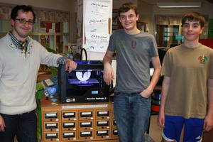 Matt Jurick, Ben Politte and Jack McKechnie display the MakerBot 3-D printer