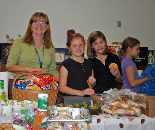 Karen Larkin and BHCS students serve food at the holiday craft fair