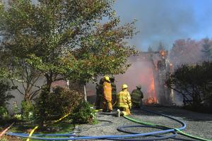Firefighters battle a blaze on Pleasant Street in Blue Hill