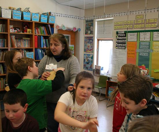 Kathy Allen helps a group of second-graders