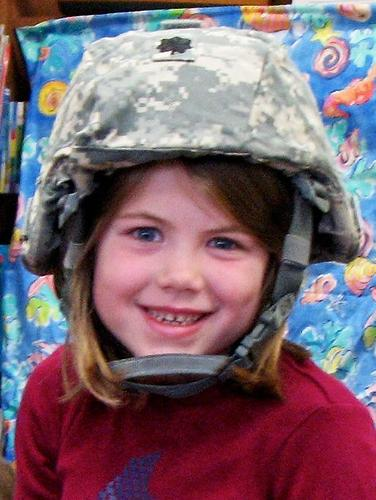 Brooksville student Ella Hutchins tries on military equipment