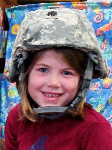 Brooksville student Ella Hutchins tries on military equipment