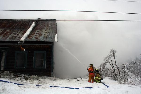 Firefighters battle structure fire on the Range Road in Blue Hill on December 30.